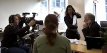 a corporate video production shoot in process with actor kim knuckey and production crew
