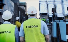 fredon air employees overlooking construction site